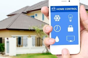 Hand holding mobile smart phone with smart home application on s